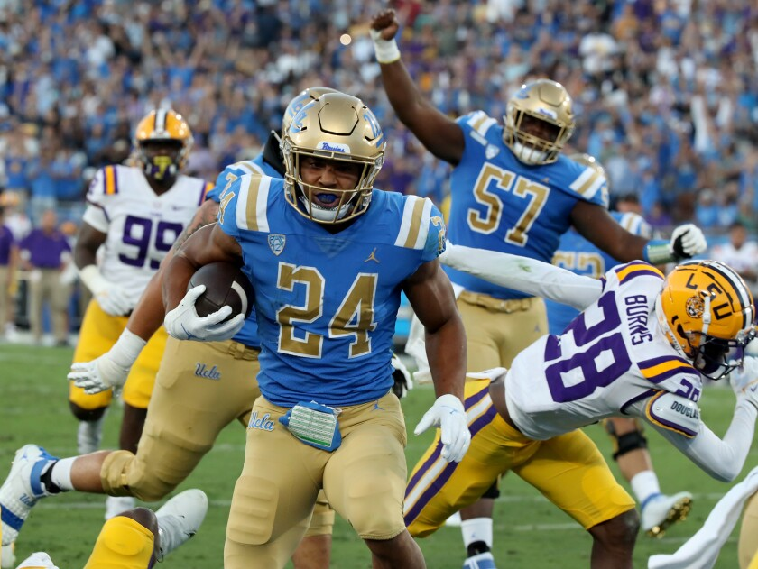 UCLA running back Zach Charbonnet runs untouched into the end zone for a score against LSU in the second quarter.