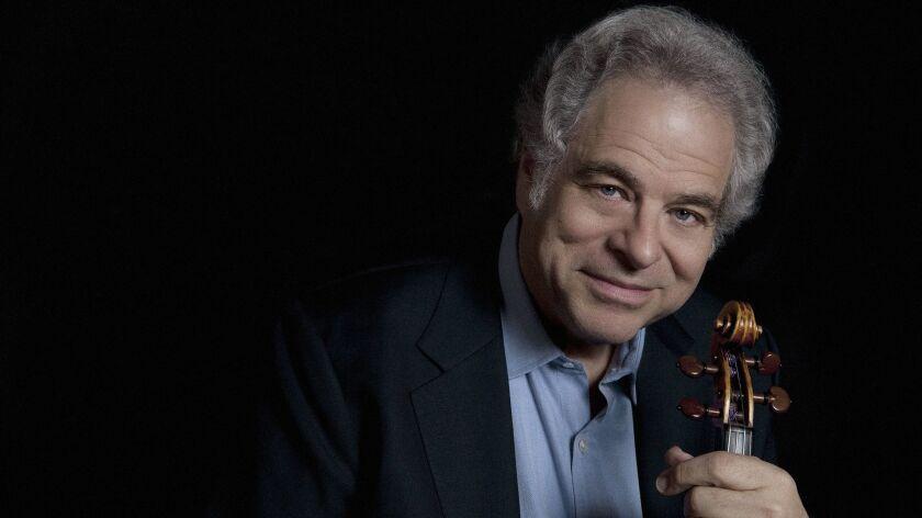 A photograph of violinist/ conductor Itzak Perlman. Credit: Marie Mazzucco