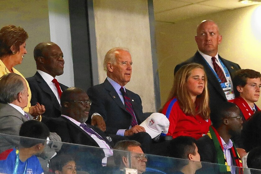 Vice President Joe Biden watches the World Cup match between the U.S. and Ghana in Natal, Brazil. He will head later to Central America to meet with leaders over the wave of child immigrants coming into the United States.