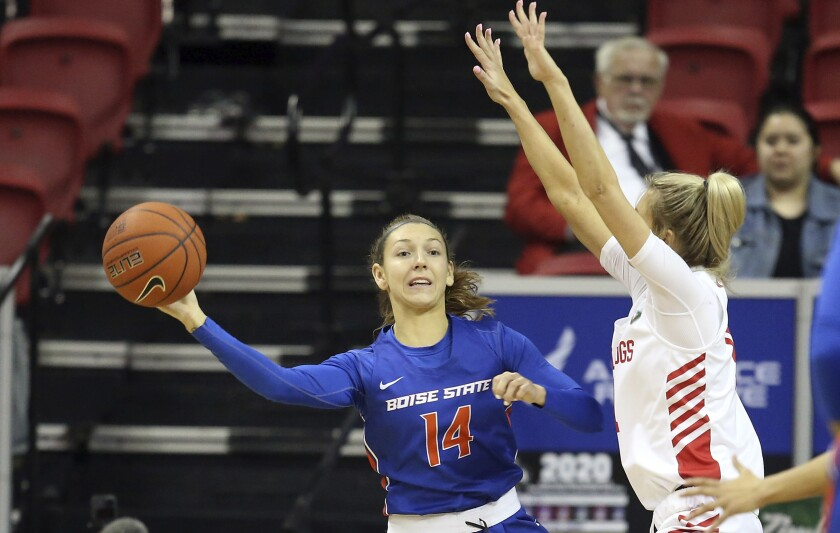 Boise State's Braydey Hodgins (14) passes the ball as Fresno State's Maddi Utti (11) defends during the first half of an NCAA college basketball game for the Mountain West Conference women's tournament championship Wednesday, March 4, 2020, in Las Vegas. (AP Photo/Isaac Brekken)