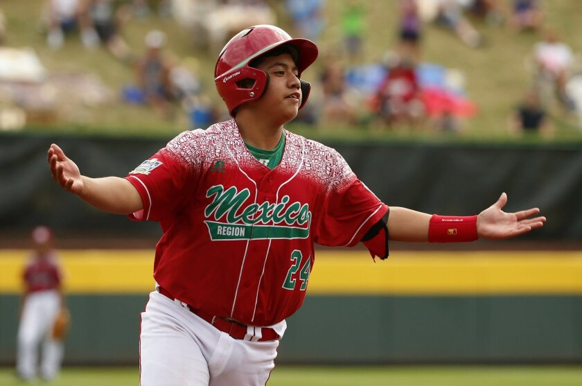 Mexico's Raul Leon (24) celebrates as he rounds third after hitting a three-run home run off Taiwan's Yen Cheng Yu during the first inning of an International elimination baseball game at the Little League World Series tournament, Tuesday, Aug. 25, 2015, in South Williamsport, Pa. (AP Photo/Gene J. Puskar)