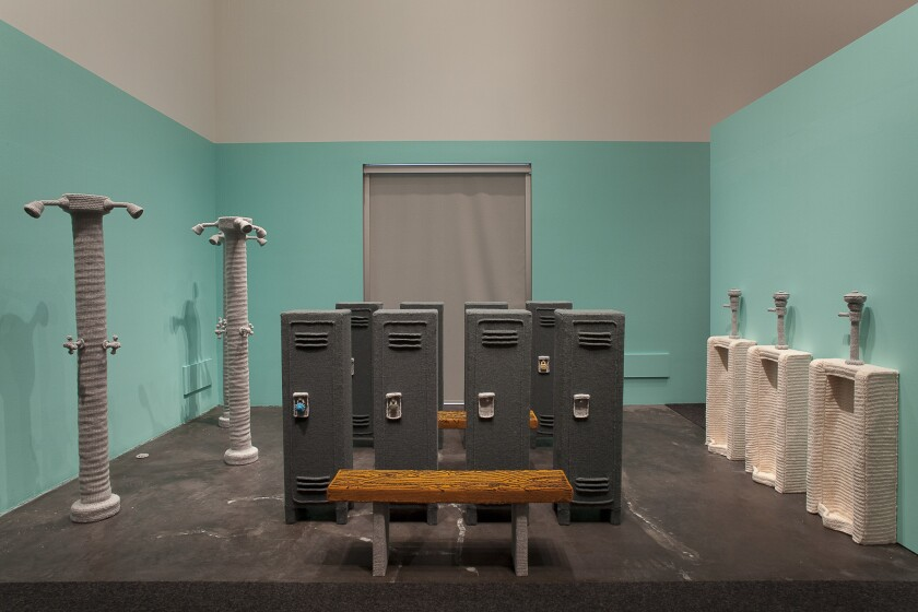 "Nathan Vincent's ""Locker Room,"" 2011. Lion Brand yarn, foam and wood. 144 inches by 228 inches by 144 inches. ""The locker room used to be a shrine to masculinity,"" says the artist, who purposely made the lockers shorter than real life, and separated from one another, creating a sense of exposure."