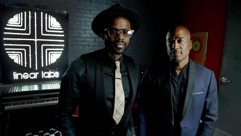 Adrian Younge and Ali Shaheed Muhammad are shown at Younge's studio in Highland Park.