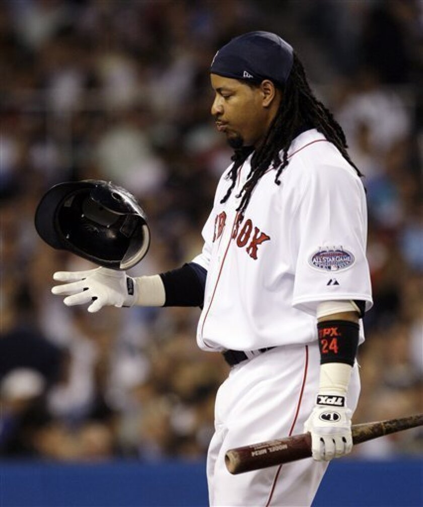 In this July 15, 2008 file photo, Boston Red Sox's Manny Ramirez, of the American League team, flips his helmet after striking out in the second inning against the National League in the Major League Baseball All-Star Game at Yankee Stadium in New York. The Red Sox finally parted ways with their disgruntled slugger, sending him to the Los Angeles Dodgers in a startling, three-team trade Thursday that brought Jason Bay to Boston, a person familiar with the deal told The Associated Press. (AP Photo/Kathy Willens)