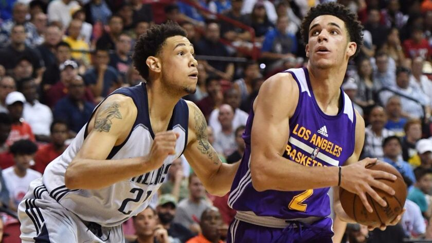 Lakers' Lonzo Ball, right, looks to drive against the Dallas Mavericks' Brandon Ashley during a semifinal game in the Las Vegas Summer League.