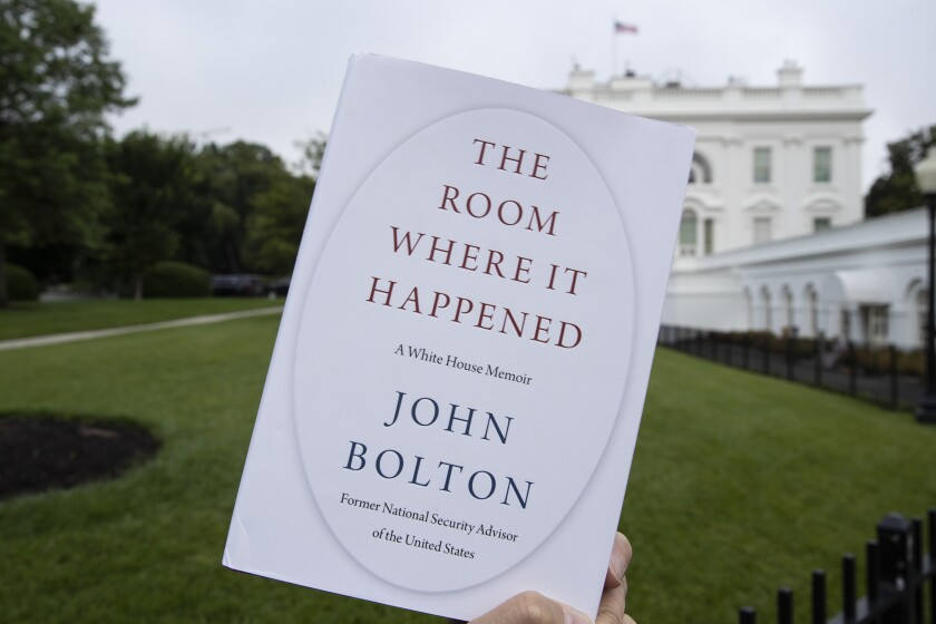 "FILE - In this June 18, 2020, file photo a copy of ""The Room Where It Happened,"" by former national security adviser John Bolton, is photographed at the White House in Washington. Trump administration officials repeatedly exerted political pressure in an unsuccessful effort to block the release of former national security adviser John Bolton's tell-all book, a career government records professional said in a court filing Wednesday, Sept. 23. (AP Photo/Alex Brandon, File)"