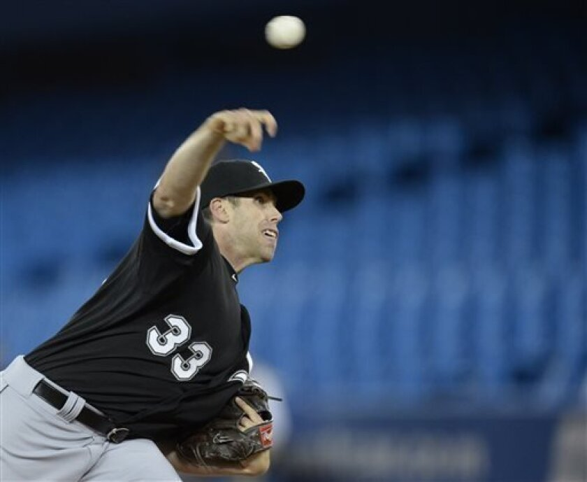 Chicago White Sox starting pitcher Dylan Axelrod throws against the Toronto Blue Jays during the first inning of a baseball game in Toronto on Tuesday, April 16, 2013. (AP Photo/The Canadian Press, Frank Gunn)