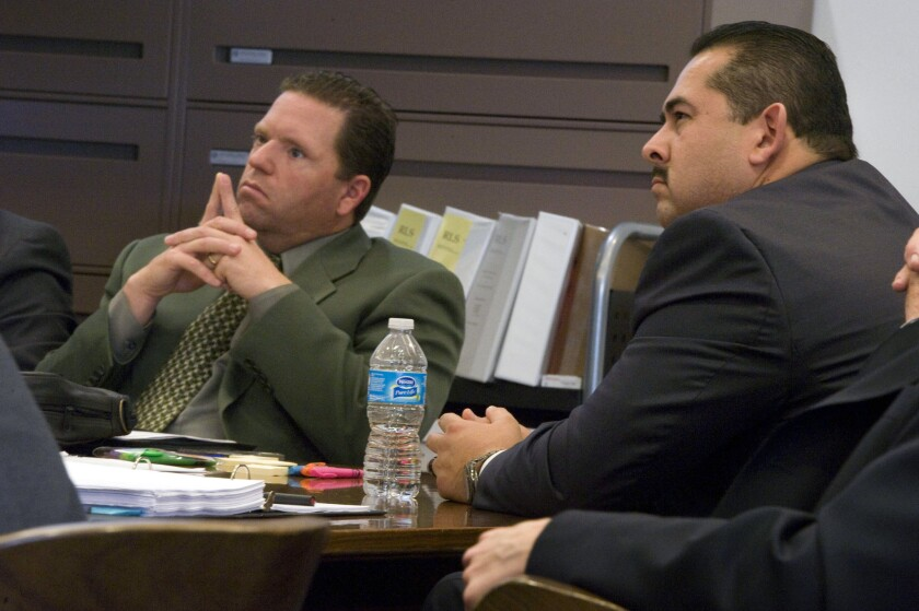 Former Fullerton police officers Jay Cicinelli, left, and Manuel Ramos in court.