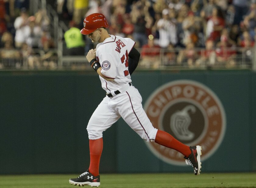 Washington Nationals' Bryce Harper circles the bases after hitting a solo homer off St. Louis Cardinals starting pitcher Mike Leake during the sixth inning of a baseball game at Nationals Park, Thursday, May 26, 2016, in Washington. (AP Photo/Pablo Martinez Monsivais)