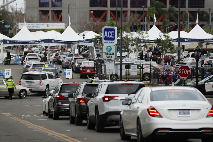 Cars in line for COVID-19 vaccine shots at the Petco Park