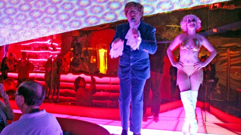Richard Halpern, portraying Austin Powers, and a go-go dancer entertained the crowd at the Electric