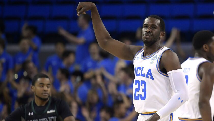 UCLA guard Prince Ali celebrates after hitting a three-point shot.