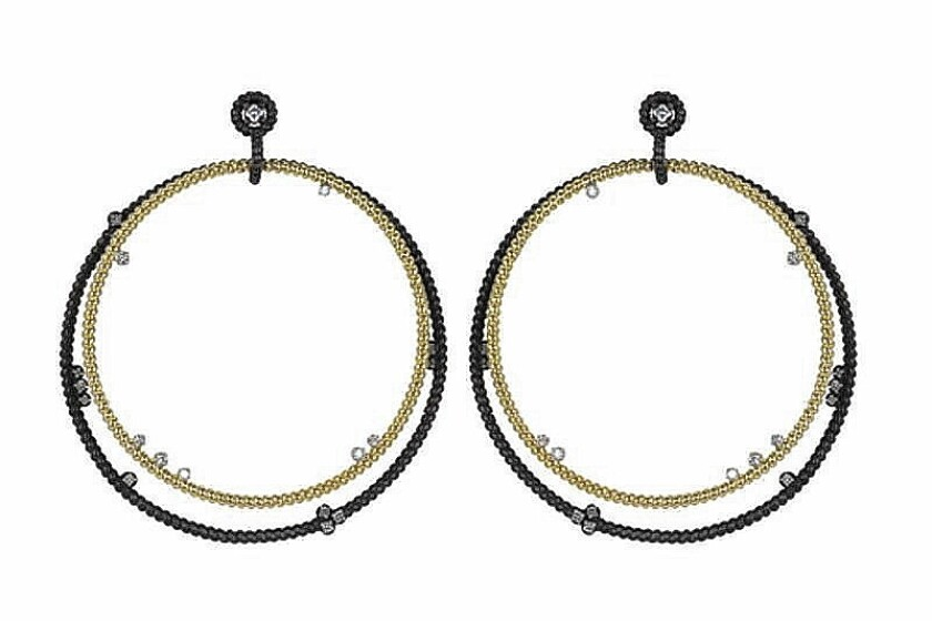 Nancy Newberg mixes metals with these oxidized silver, gold and diamond floating hoops, priced at $2,800.