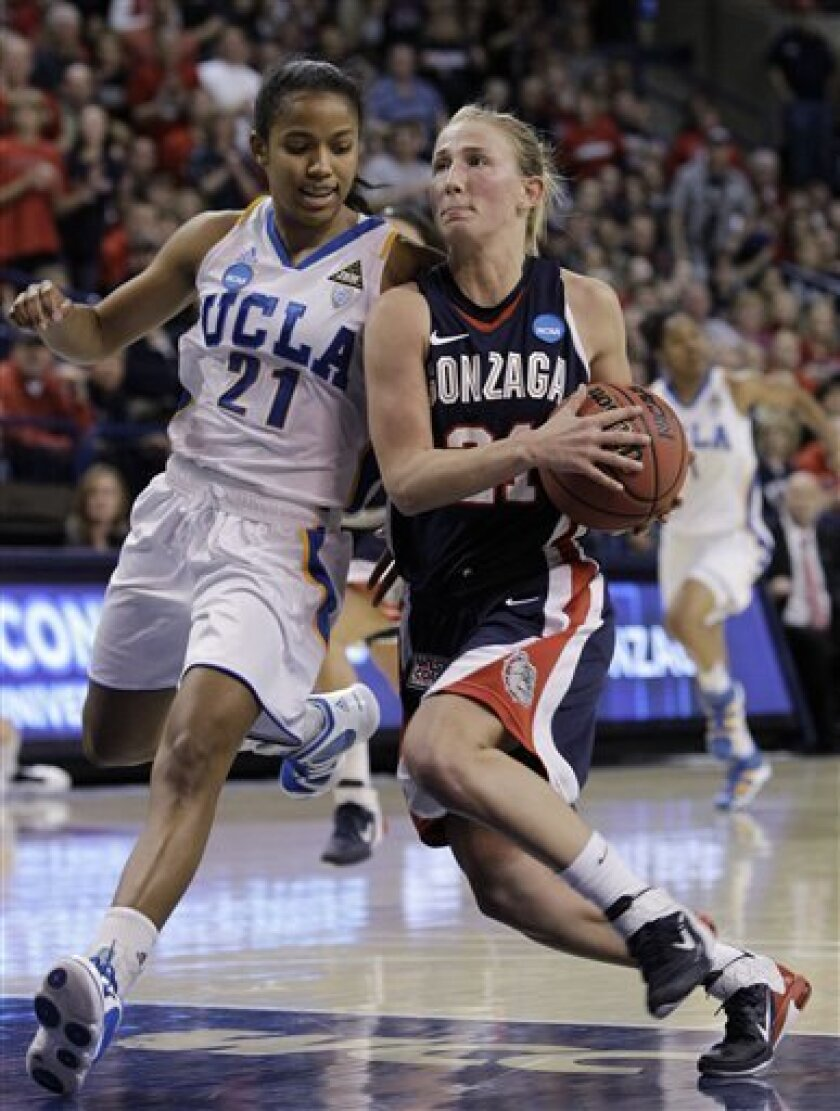 UCLA's Doreena Campbell, left, defends as Gonzaga's Courtney Vandersloot drives the lane during the first half of their second-round game of the NCAA women's college basketball tournament Monday, March 21, 2011, in Spokane, Wash. (AP Photo/Elaine Thompson)