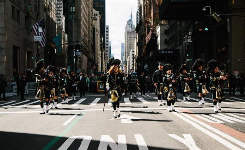 Bagpipers perform as they march during the St. Patrick's Day Parade in New York, New York, USA, 16 March 2019. The annual event is the largest St. Patrick's Day Parade in the United States. St. Patrick's Day is marked annually on 17 March to commemorate Saint Patrick, the patron saint of Ireland. EPA/EFE