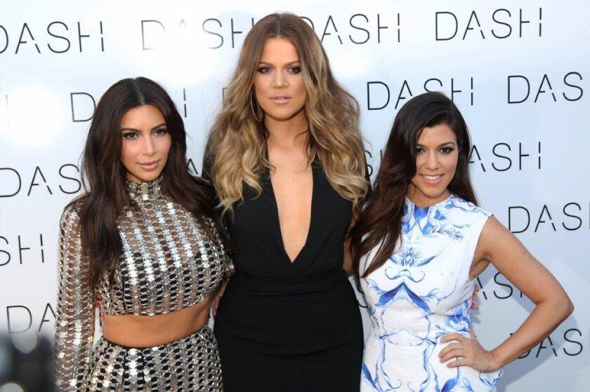 a44592bf Kourtney Kardashian sans pants is only part of sisters' Miami visit ...