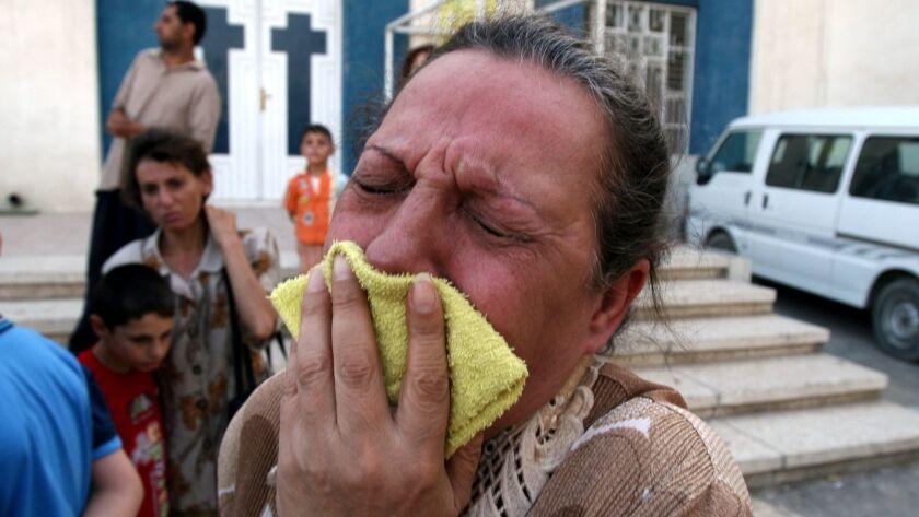 An Iraqi Christian woman cries outside a church in Baghdad Jadidah in Baghdad, Iraq on June 10, 2007.