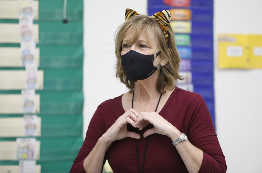 A teacher wearing a mask and cat ears