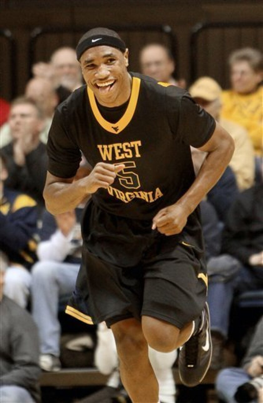 West Virginia's Kevin Jones reacts after making a basket in the first half of an NCAA college basketball game against Rutgers in Morgantown, W.Va., on Wednesday, Jan. 6, 2010. (AP Photo/David Smith)