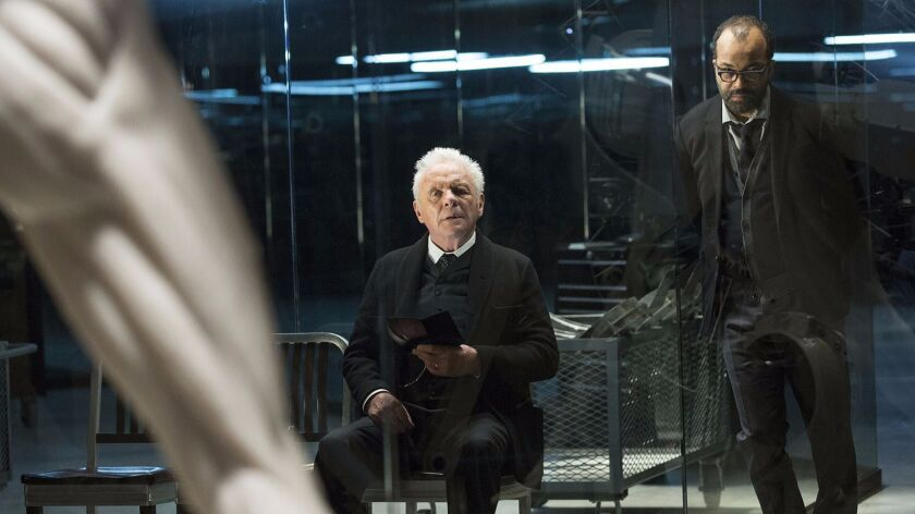 "Anthony Hopkins, left, and Jeffrey Wright in a scene from ""Westworld."""