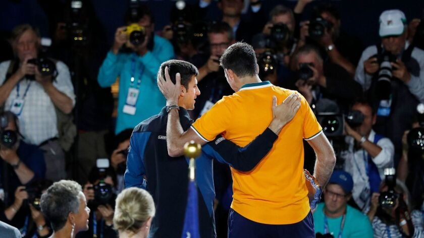 Novak Djokovic celebrates with Juan Martin del Potro after the men's final of the US Open in New York.