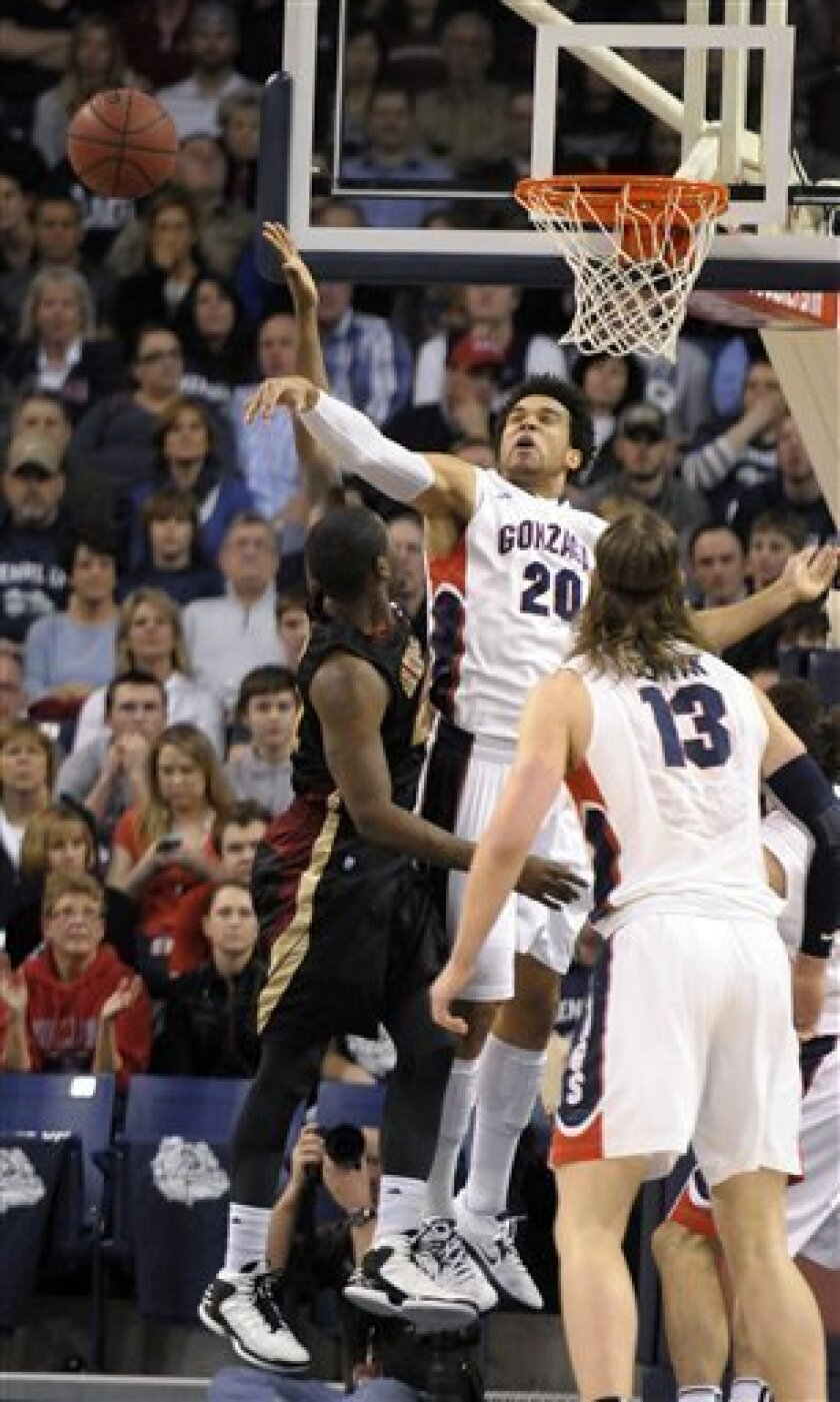 Gonzaga's Elias Harris (20) blocks Santa Clara's Kevin Foster in the first half of an NCAA college basketball game, Wednesday, Feb. 20, 2013, in Spokane, Wash. (AP Photo/Jed Conklin)