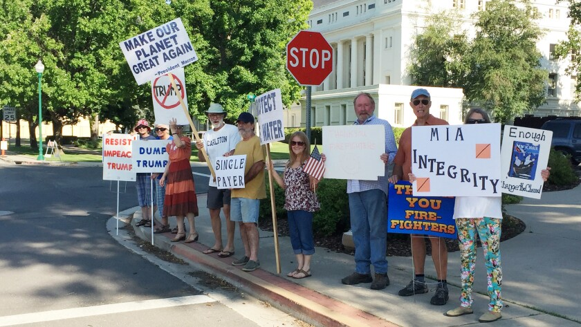 A group of liberal voters stands outside the Plumas County Courthouse in Quincy every Friday, snow o