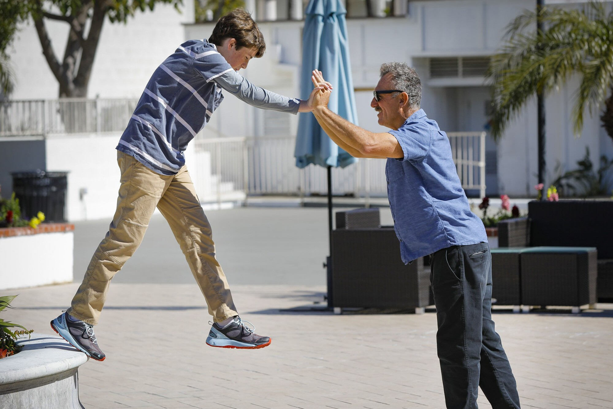 Otto Lana, left, plays with his dad, Claudio Lana, right, during the 36th annual Cal-TASH conference on disability rights at the Town and Country San Diego. Otto has autism and apraxia which prevents him from speaking words with his mouth.