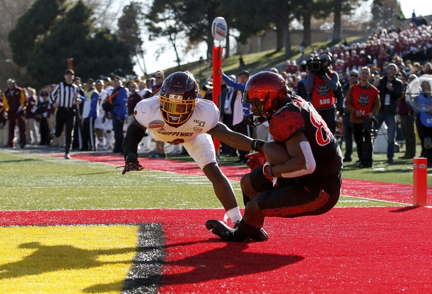 San Diego State wide receiver TJ Sullivan pulls in a 29-yard touchdown catch as Central Michigan defensive back Da'Quaun Jamison defends during the second half of the New Mexico Bowl.