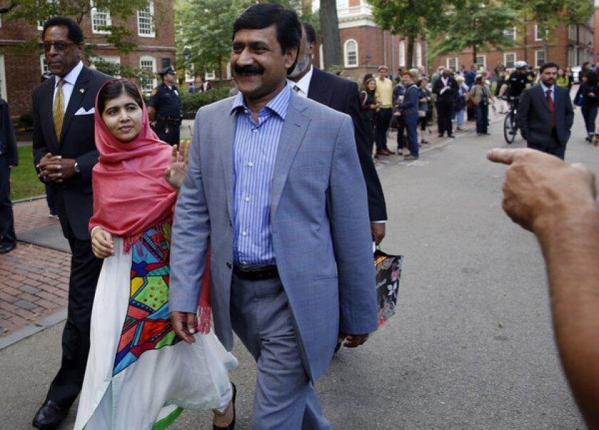 Malala Yousafzai with her father, Ziauddin Yousafzai, at Harvard University in March.