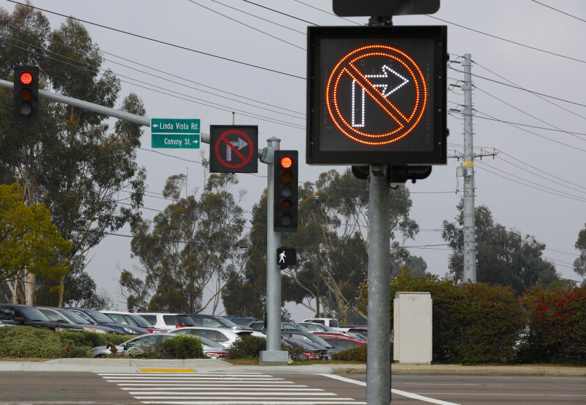 "A ""No Right Turn"" sign lights up alerting drivers that they cannot yield for right turn onto Convoy Street in Linda Vista."