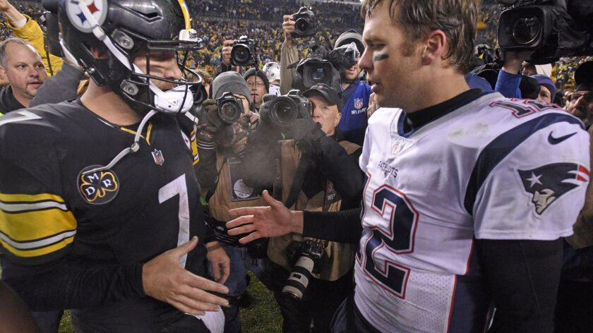 In this Dec. 17, 2017, file photo, Pittsburgh Steelers quarterback Ben Roethlisberger (7) and New England Patriots quarterback Tom Brady (12) meet on the field following a game in Pittsburgh. New England plays at Pittsburgh this week.
