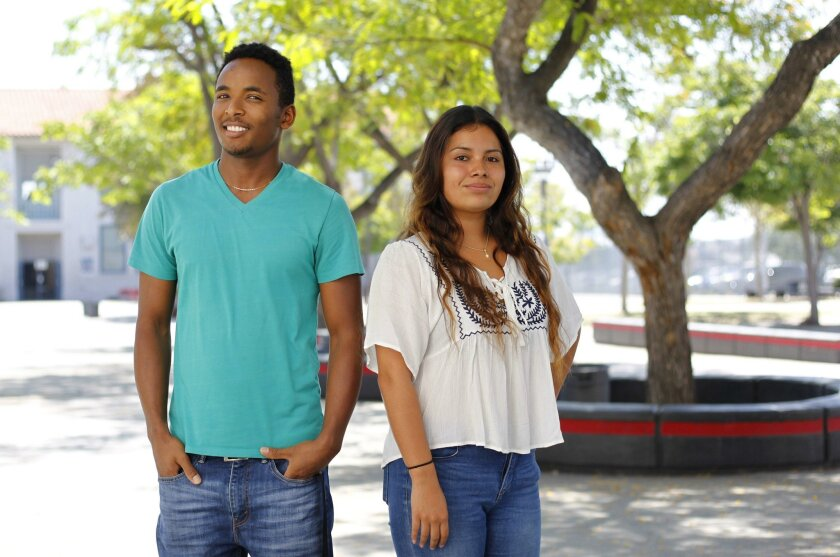 Hoover High seniors Tullue Huka, left, Alison Sanchez were able to opt out of the foreign language class requirement by proving the mastery of their native language by passing a test in it.