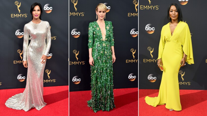 Sparkly jewel tones and metallics ruled the red carpet at the Emmys on Sunday. From left, Padma Lakshmi, Sarah Paulson and Angela Bassett.