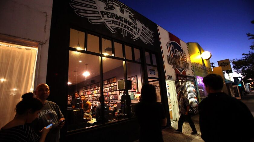 A group of people wait for a band to perform at Permanent Records on York Boulevard.