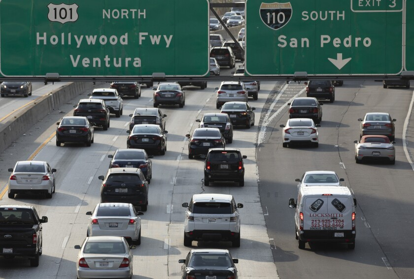 Several vehicles on a freeway.