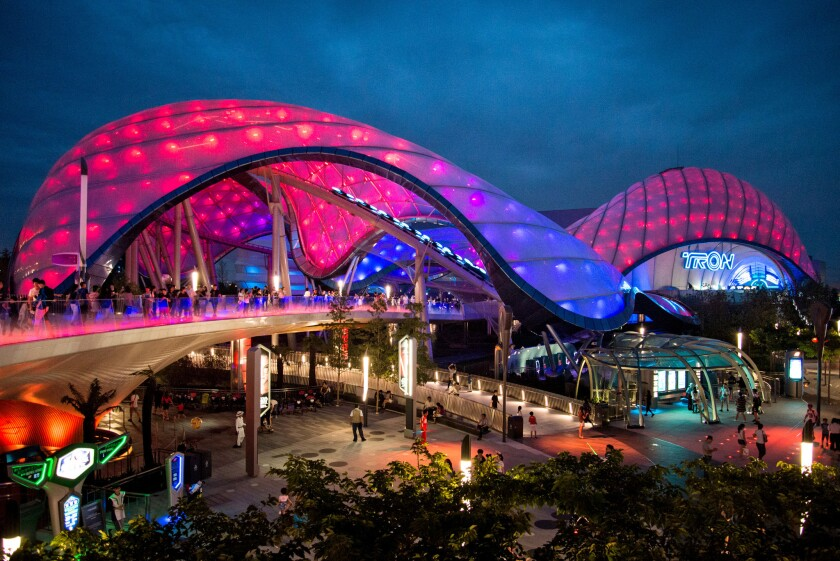 The amoeba-like structure that houses Tron Lightcycle Power Run at Shanghai Disneyland pulses seductively with music and light.