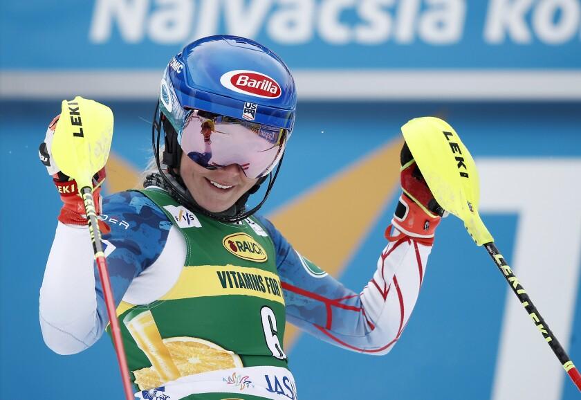 United States' Mikaela Shiffrin celebrates in the finish area after winning an alpine ski, World Cup women's slalom in Jasna, Slovakia, Saturday, March 6, 2021. (AP Photo/Gabriele Facciotti)