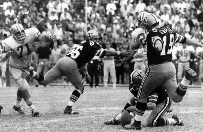 Tom Dempsey kicks a 63-yard field goal in New Orleans on Nov. 8, 1970. The record-setting kick gave the Saints an upset 19-17 win over the Lions. Joe Scarpati is the holder. Detroit's Alex Karras (71) and Saints' Bill Cody (66) are also pictured.
