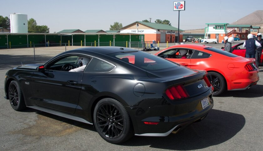 Black Mustang GT & red Mustang with EcoBoost