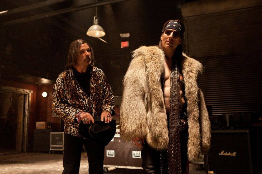 """Alec Baldwin as Dennis Dupree and Tom Cruise as Stacee Jaxx in """"Rock of Ages."""" Photo by David James"""