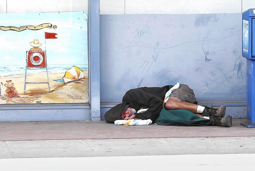 Homeless man asleep in Laguna Beach