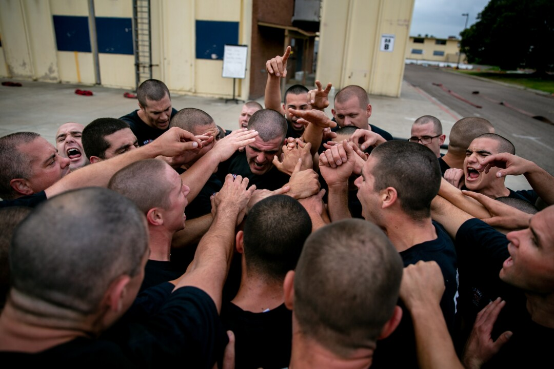 "Recruits huddle together and chant ""87! 87! 87!"" after completing their morning exercise. Their instructor pointed out that they'd left one of their fellow recruits behind."