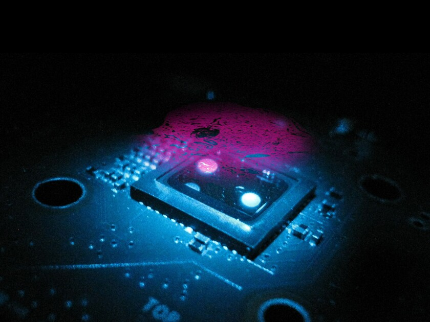 A new type of microscope: Holograms of a sample slide are captured using an image sensor chip, and then digitally reconstructed into a 3-D image.