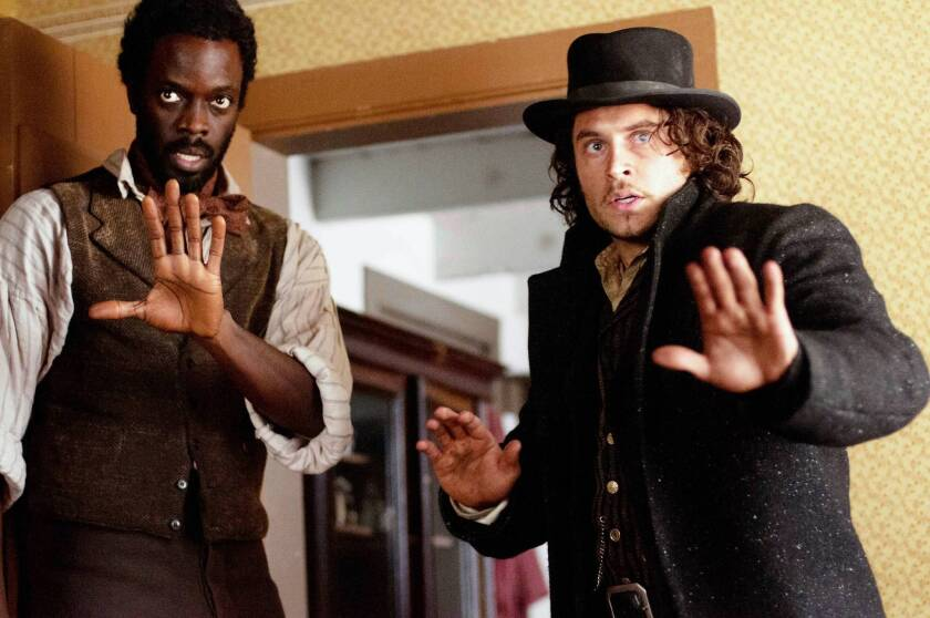 """Matthew Freeman (Ato Essandoh), left, and Detective Francis Magurie (Kevin Ryan) in """"Cooper."""""""