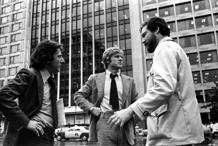 "Black-and-white image of Dustin Hoffman, from left, and Robert Redford on the ""All the President's Men"" set in 1976 with director Alan Pakula."