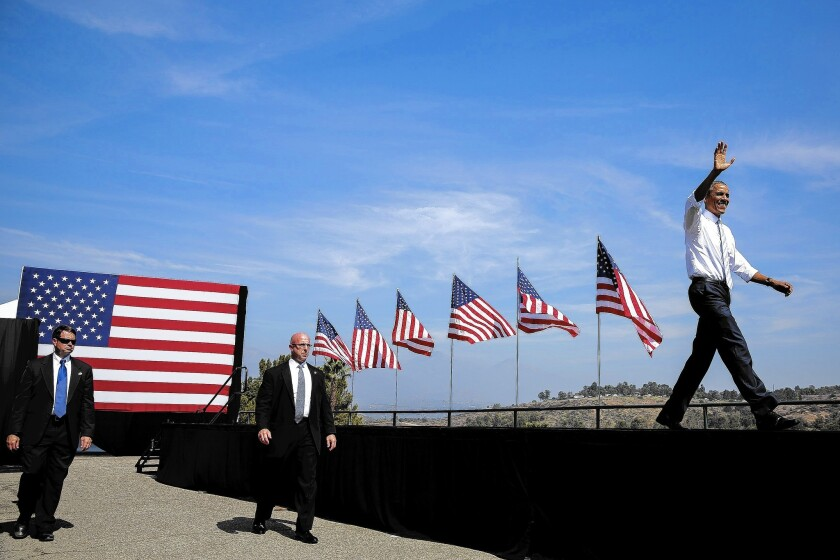 """President Obama waves at Frank G. Bonelli Regional Park in San Dimas after formally designating the San Gabriel Mountains National Monument. Obama compared the history of the range to """"the story of America."""""""