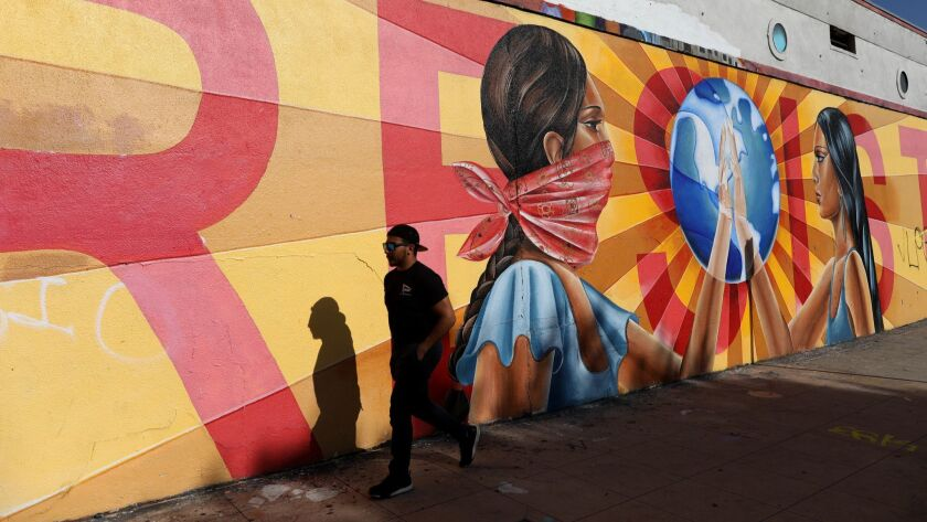 """A mural painted on the wall of Self Help Graphics at 1300 E. 1st St. in Boyle Heights in Los Angeles is seen on April 14, 2018. The industrial area of Boyle Heights known as """"The Flats"""" has been the site of recent anti-gentrification battles that have targeted art galleries."""