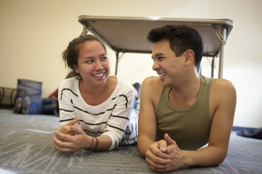 "Taylor M. Wycoff and Sean Tuazon rehearse a scene from Lisa Kirazian's ""Switch,"" a play that alternates with young dramatists' contest-winning plays in this year's edition of the annual Playwrights Project festival."