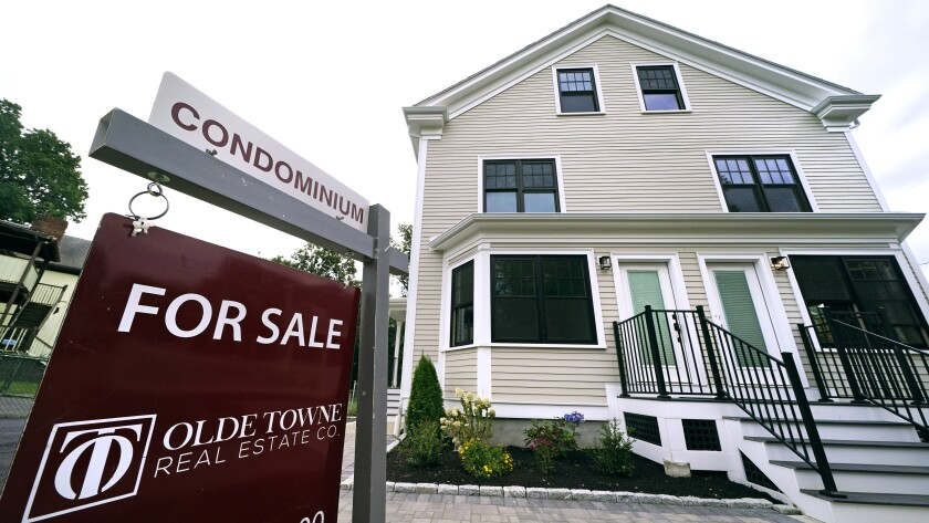 Condominium units are offered for sale in the Dorchester neighborhood, Wednesday, Aug. 18, 2021, in Boston. Mortgage buyer Freddie Mac said Thursday, Sept. 2, that the average rate for a 30-year mortgage held at 2.87% as demand for homes remained stable. The benchmark rate, which peaked this year at 3.18% in April, stood at 2.93% this time last year. (AP Photo/Charles Krupa)